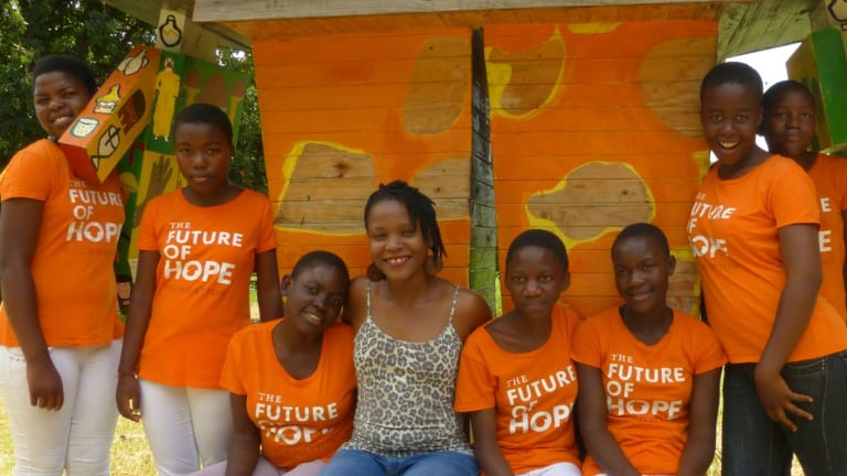 Chido Govera with girls from the Future of Hope Foundation.