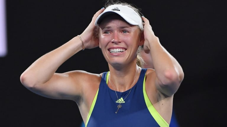 Caroline Wozniacki tears up as she takes in her triumph.