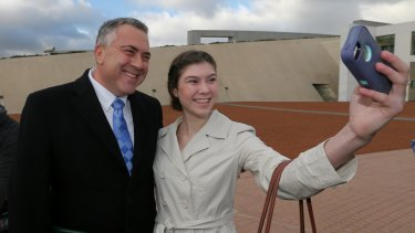 Treasurer Joe Hockey poses for a selfie with Anika Buining during a morning doorstop at Parliament.