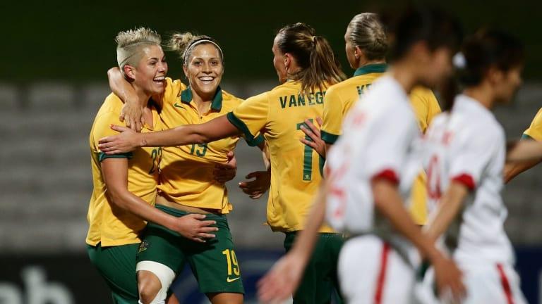 Michelle Heyman celebrates with Australian teammates.