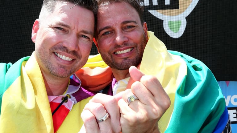 Scott D'Amico and Brad Harker celebrate after the same sex marriage vote result announcement in Queens Park in Brisbane on Wednesday.