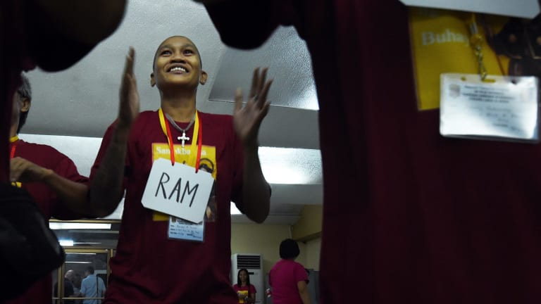 Ramson Donado dances with fellow patients during a community rehabilitation program at San Roque Church in Manila.