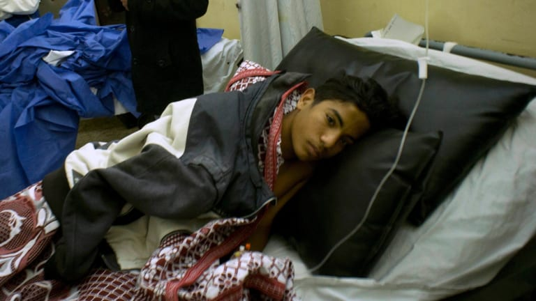 Abdallah Abdel Nasser, 14, receives medical treatment after he was in injured during the attack that killed at least 305 people.