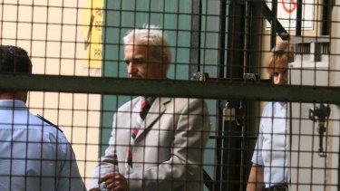 Dragan Vasiljkovic aka Daniel Sneddon, known as Captain Dragan is led by corrective services guards into the van at Central Local Court in Perth in 2007