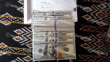 Money allegedly used by an Australian official to pay a people trafficker called Indra.