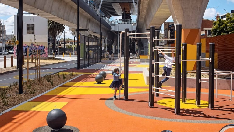 Designed by ASPECT Studios, a space under Skyrail entices children to its playground.