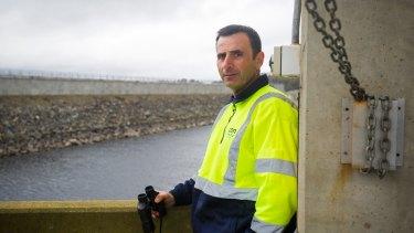 Water industry operator Rob Tonna overlooking Googong dam.