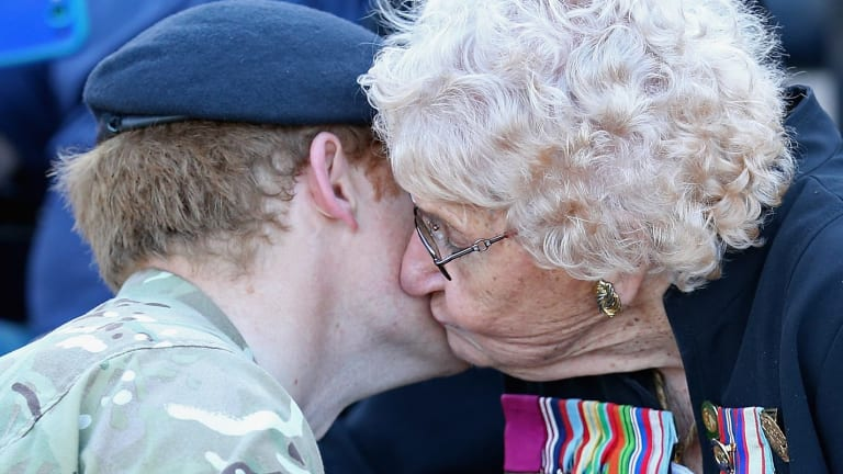Prince Harry meets Daphne Dunne, who is wearing her husband's Victoria Cross.