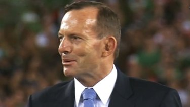 """Footy fans shouldn't be subjected to a politicised grand final"": Tony Abbott, pictured at the 2014 NRL grand final."