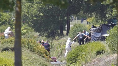 French crime scene investigators examine the site where the remains were located.