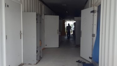 Shipping containers used as accommodation on Manus Island.