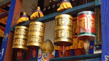 Spinning a prayer wheel helps accumulate wisdom and good karma in Bhutan.