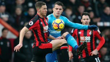 Bournemouth's Dan Gosling and Arsenal's Granit Xhaka fight for te ball at Vitality Stadium in Bournemouth on Sunday.