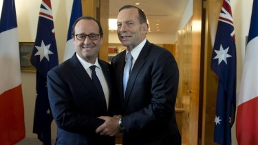 French connection: Tony Abbott (pictured with French President Francois Hollande) says it is essential that countries set a strong binding emissions reductions target at the 2015 climate conference in Paris.