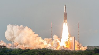 The rocket carrying Sky Muster II lifts off.
