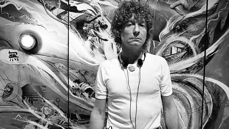 Brett Whiteley in front of his monumental multi-panel piece The American Dream in 1983.