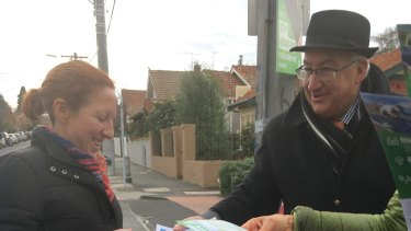 Michael Danby hands out his how to vote cards on election day.