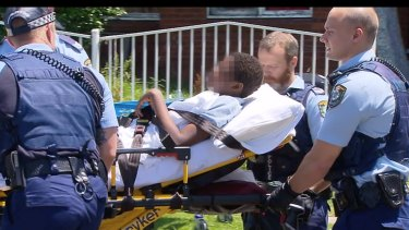 Police remove the boy from his Blacktown home.