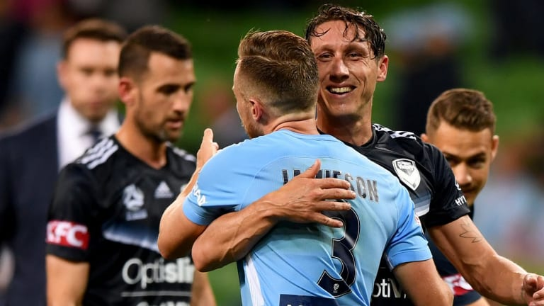 Reason to smile: Mark Milligan is congratulated by City's Scott Jamieson after converting his spot kick in added time.
