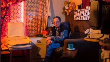 """Life has been up and down for me"": Clive, 67, sits in his Waterloo flat."