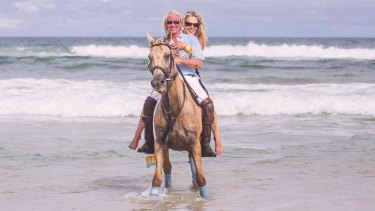 Breaking in: Chris Murphy and wife Caroline ride the waves.