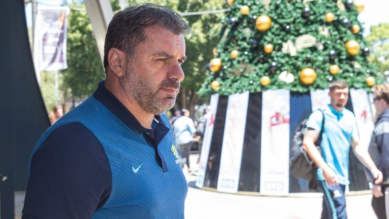 Socceroos coach Ange Postecoglou arrives with team at Sydney Airport on Sunday.