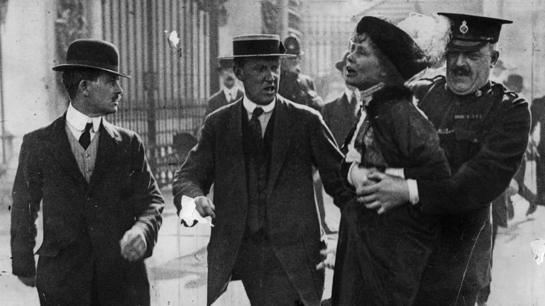 Suffragette leader Emmeline Pankhurst (1858-1928)  is arrested outside Buckingham Palace. The suffragette movement often faced backlash and outrage at their conduct.