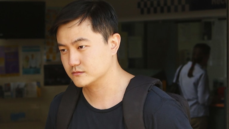 Sicen Sun, who allegedly made replica guns with a 3D printer, leaves court after being released on bail.