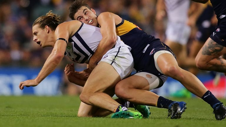 Dockers captain Nat Fyfe is tackled by Elliot Yeo, of the Eagles, during the round six derby.