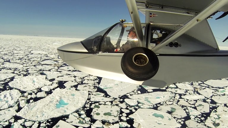 Michael Smith flies over ice floes between Iceland and Greenland.