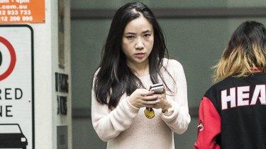 Yingying Dou leaves the Sydney premises where she works.