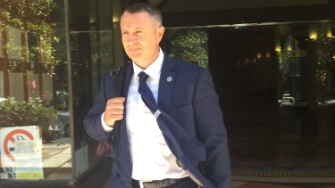 Suspended AFP officer Ben Hampton leaves Downing Centre District Court on Wednesday.