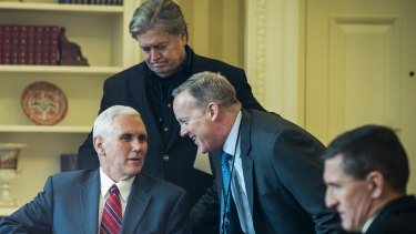 Chief of staff Reince Priebus, left, and chief strategist Stephen Bannon, back, met with Mr Hockey this month.