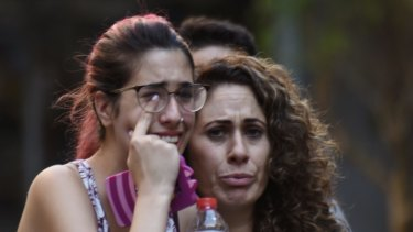 People flee from the scene after the van attack in the historic Las Ramblas district of Barcelona, Spain.