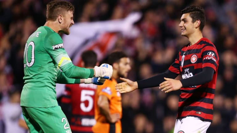 Wanderers goalkeeper Andrew Redmayne celebrates with Daniel Alessi after the Wanderers' FFA Cup round-of-32 win over Brisbane Roar earlier this month.