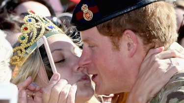When Harry met Vicky: Prince Harry is kissed by royal fan Victoria McRae during a walkabout outside the Sydney Opera House.