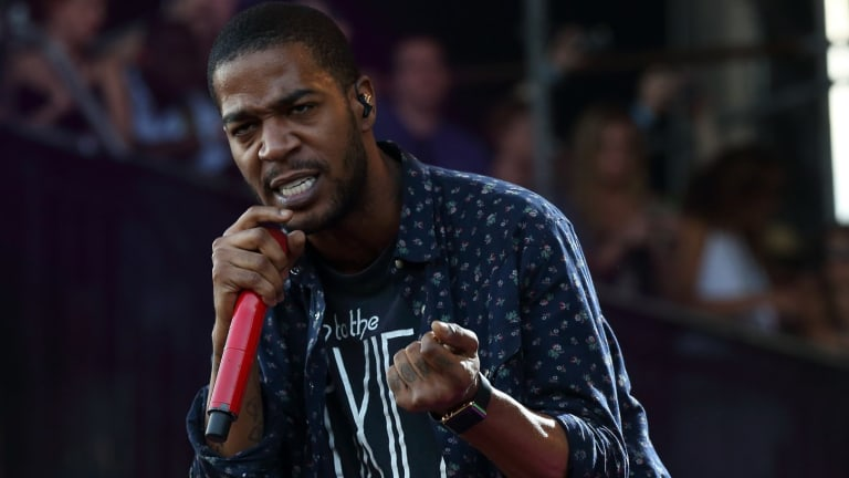 Gone to rehab: Kid Cudi says he's been battling depression everyday, even when pictured here performing at the Lollapalooza Music Festival in Grant Park in Chicago.