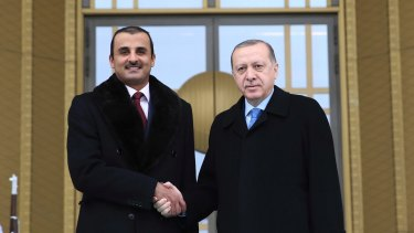 Qatari Sheikh Tamim bin Hamad Al Thani, left, with Turkish  President Recep Tayyip Erdogan on Monday. The sheikh's visit to Ankara came as UAE officials claimed Qatar fighter jets intercepted commercial flights in international airspace.