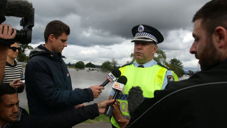 Inspector Brian Tracey, of Maitland police, talks to the media at Cessnock Road.