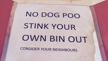 Dog walkers are on notice in Stanmore. The laminated sign shows how serious this person is about keeping doggie doo out of their bin.