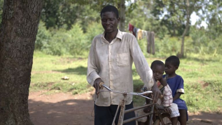 Boniface, four-year-old George and five-year-old Alice travelled 3.5 hours by bicycle in Kenya to get treatment.