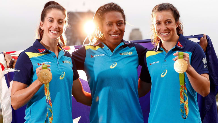 Alicia Quirk, Ellia Green and Emilee Cherry pose with their Olympic gold medals after the Australian women's sevens team were awarded Order of Australia Medals.