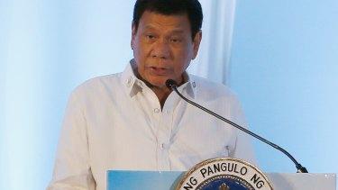 Philippine President Rodrigo Duterte addresses delegates of the ASEAN Business and Investment Summit in Laos.