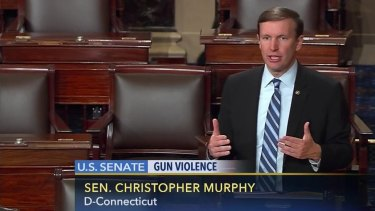 Filibuster: Chris Murphy on the floor of the Senate during the filibuster demanding a vote on gun control measures.