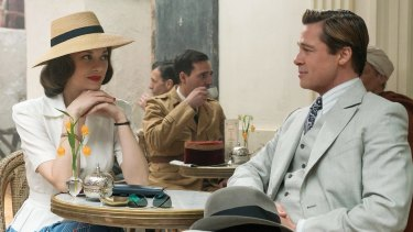Marion Cotillard and Brad Pitt in a scene from <i>Allied</i>.