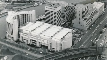 The former convention centre, the white building pictured centre, was completed in 1990. It is now being demolished.