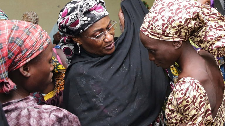 In an earlier incident in October, one of the released girls freed from Boko Haram is met by a Nigerian government official in Abuja.