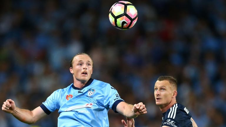 Rhyan Grant of Sydney FC and Besart Berisha of the Victory contest possession.