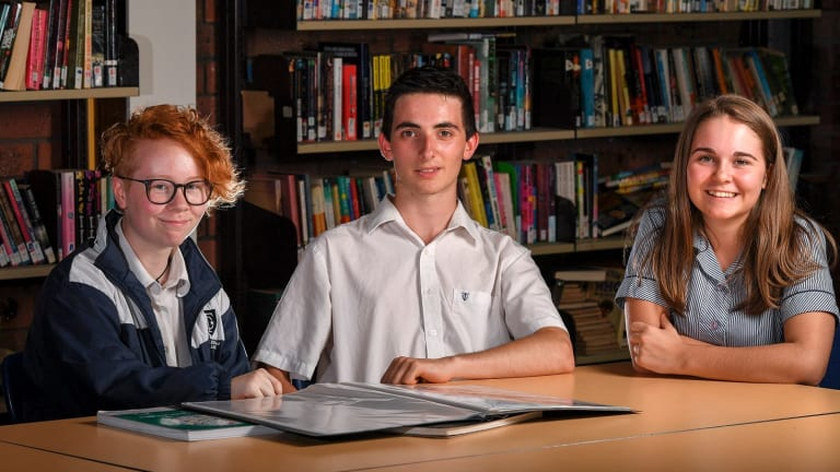 Templestowe College students (from left) Stevie, Liam and Melanie are doing the unscored VCE and will finish without an ATAR.