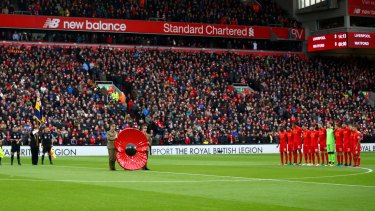 Liverpool and Watford observe a minute's silence for Remembrance Day.